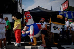 Characters and employees of the race's publicity caravan wait near the finish line.