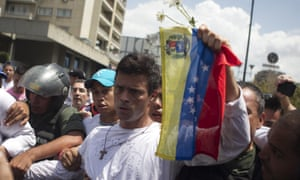 Venezuelan opposition leader Leopoldo López surrenders to military police in Caracas on 18 February 2014. He has been in jail ever since for allegedly instigating street violence.