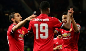Marcus Rashford is congratulated on putting Manchester United 1-0 up against Burton Albion by Matteo Darmian and Jesse Lingard