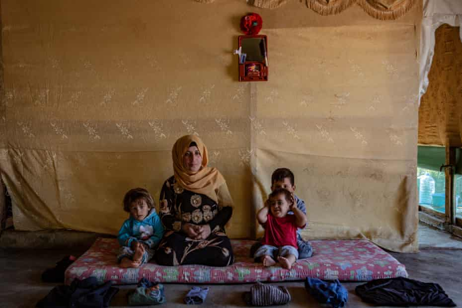 Nafla, 35, with three of her four children