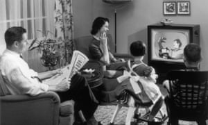 A family gathers round to watch the TV in 1955
