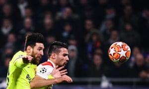 Barcelona's Lionel Messi (left) tussles with Lyon's defender Leo Dubois.