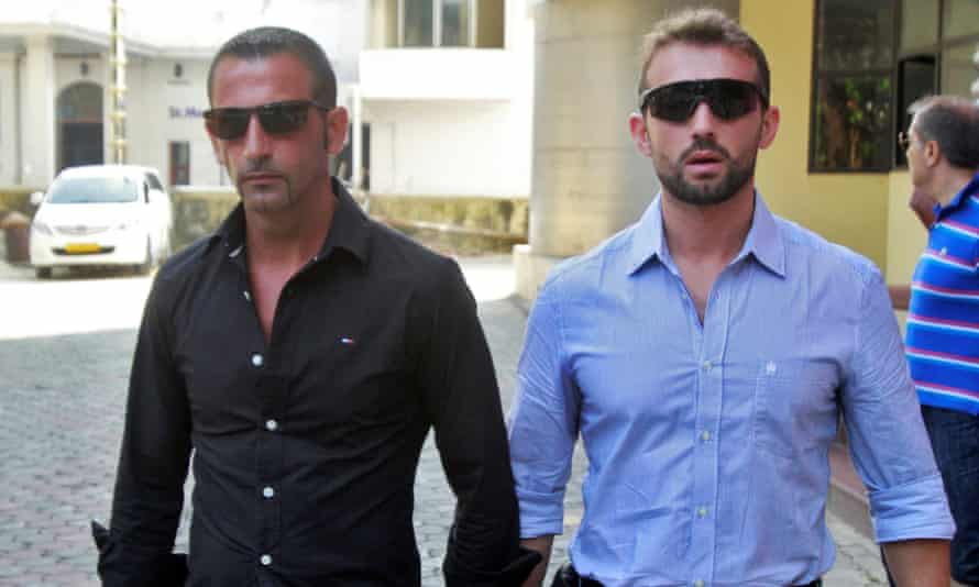 Italian marines Salvatore Girone (right) and Massimiliano Latorre leave a police commissioner's office in Kochi, India, in January 2013.