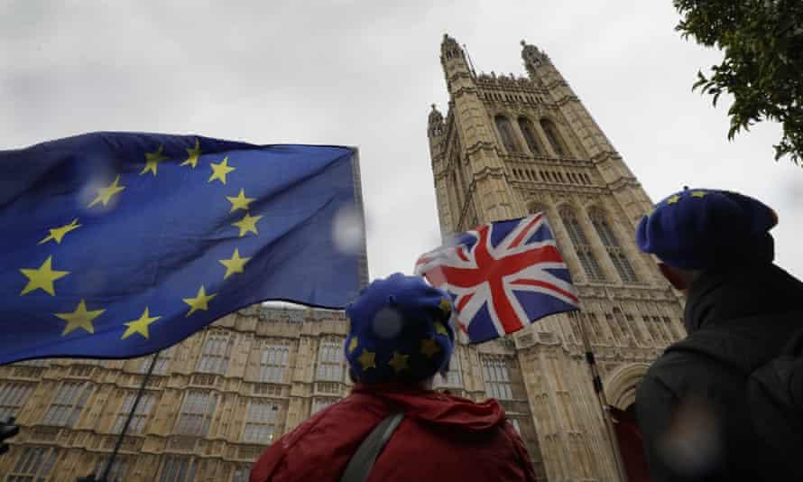 An EU and UK flag outside parliament.
