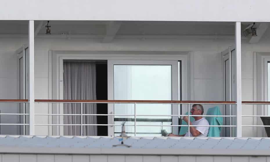 Passengers sit in quarantine aboard a cruise ship in Fremantle, Australia.