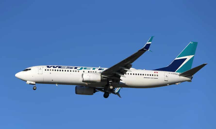A WestJet Boeing 737-800 airplane prepares to land at Vancouver's international airport in Richmond, British Columbia, Canada, in 2019.