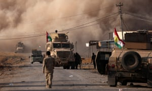 Smoke rises during clashes between Peshmerga forces and Islamic State militants in the town of Bashiqa, east of Mosul.