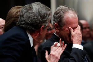 George W Bush with his brother Jeb after speaking at his father's funeral.