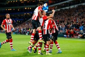 Moreno celebrates with his team-mates after scoring.