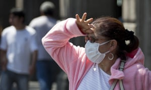 A woman wears a mask to protect herself against air pollution in Mexico City.