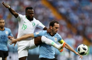 Uruguay's Diego Godin shields the ball from Fahad Almuwallad of Saudi Arabia.