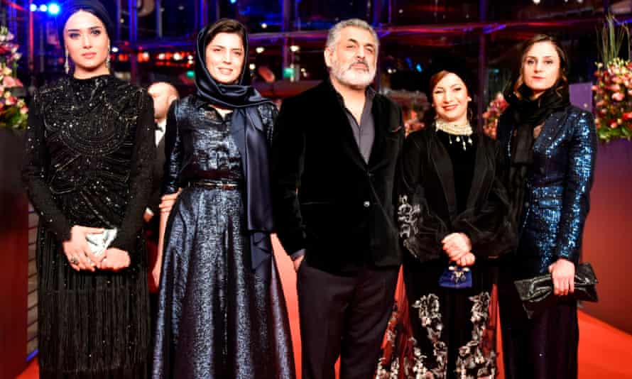 Mani Haghighi, centre, with the cast of Pig at the 2018 Berlin film festival.