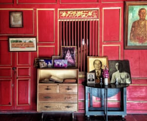 REd walls, and family portraits, Sol Heng Tai Mansion