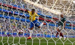 Brazil's Roberto Firmino scores their second goal.