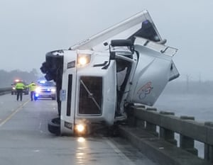 High winds tipped over this18-wheeler, killing its driver and shutting down the US64 bridge in North Carolina.