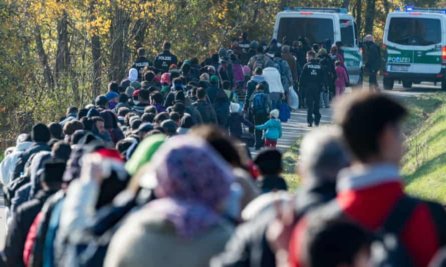 People caught up in the migration crisis cross the Austrian-German border