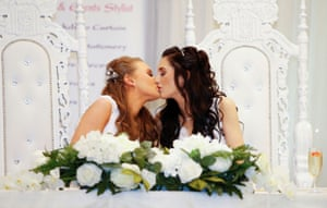 Carrickfergus, Northern Ireland Sharni Edwards and Robyn Peoples, a Belfast couple who are the first known same-sex couple to get married in Northern Ireland, kiss after being married in Carrickfergus