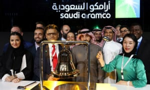 People prepare for Saudi Aramco to be listed on the stock exchange in Riyadh