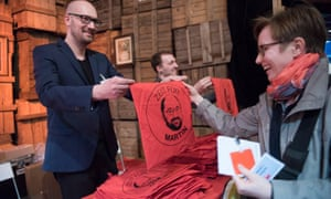 Supporters hand out bags with a picture of Martin Schulz to new Social Democrat members at a welcome meeting in Berlin/