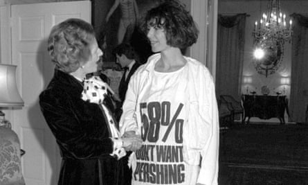 Margaret Thatcher greets Katharine Hamnett, wearing a T-shirt with a nuclear missile protest message, at 10 Downing Street, where she hosted a reception for London Fashion Week designers in 1984.