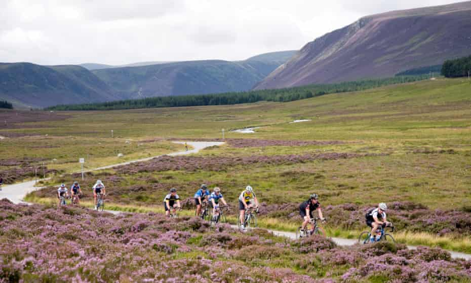 Cycling amid glorious mountain scenery in the Spittal of Glen Muick, near Ballater, Aberdeenshire.