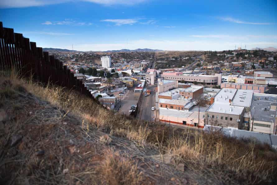 A border fence stretching through Nogales in Arizona and Nogales in Mexico. The image is part of a photo project documenting life on both sides of the US-Mexico border