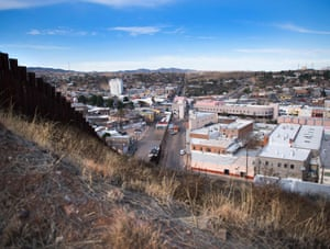 The border fence stretching through Nogales, Arizona, and Nogales, Mexico