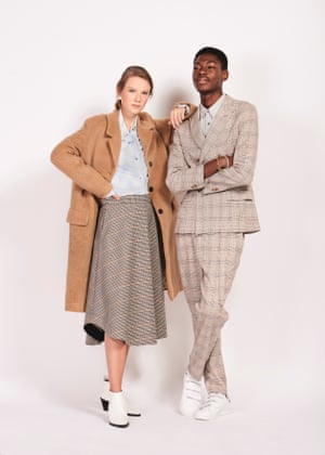Smart as a button Anna wears beige alpaca coat, £250, blue shirt, £55, and checked wool skirt, £115, all from arket.com White leather pointed ankle boots, £89.99,  mango.comSuits you sir Sandile wears blazer, £89.99, and, check suit trouser, £49.99, both zara.com White trainers £74.95, adidas.co.uk