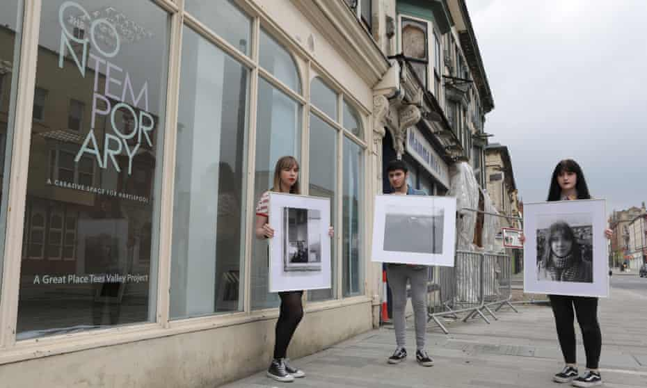 Photography students from the Northern School of Art preparing for a show of their work at Empty Shop in Hartlepool.