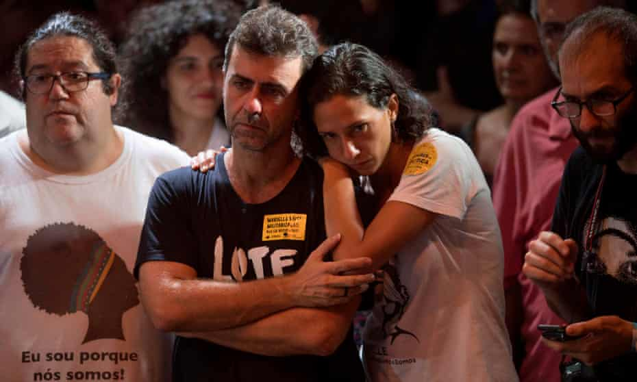 Marcelo Freixo (L), Rio de Janeiro state deputy for the Socialism and Liberty Party (PSOL) and the widow of the late activist Marielle Franco, Monica Tereza Benicio (R), attend a rally of Brazilian leftist parties at Circo Voador in Rio de Janeiro, Brazil, on April 02, 2018. The chief justice of Brazil's Supreme Court urged calm and warned against violence Monday ahead of a ruling that could send former president Luiz Inacio Lula da Silva to prison -- or give him a get-out-of-jail card. / AFP PHOTO / Mauro PimentelMAURO PIMENTEL/AFP/Getty Images