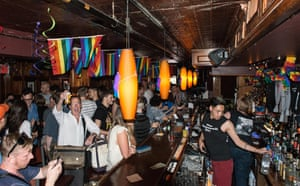 Gay rights activists celebrate at historic Stonewall Inn in New York City.