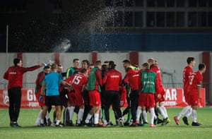 The Gibraltar players celebrate at the end of the match.