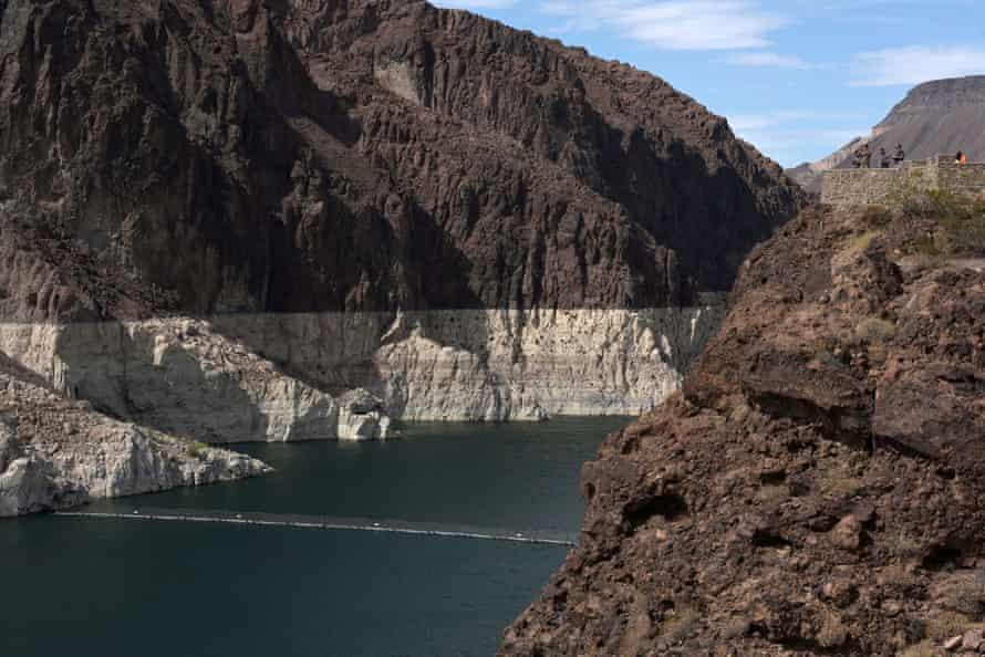 Visitors take photos in of Lake Mead near Las Vegas.