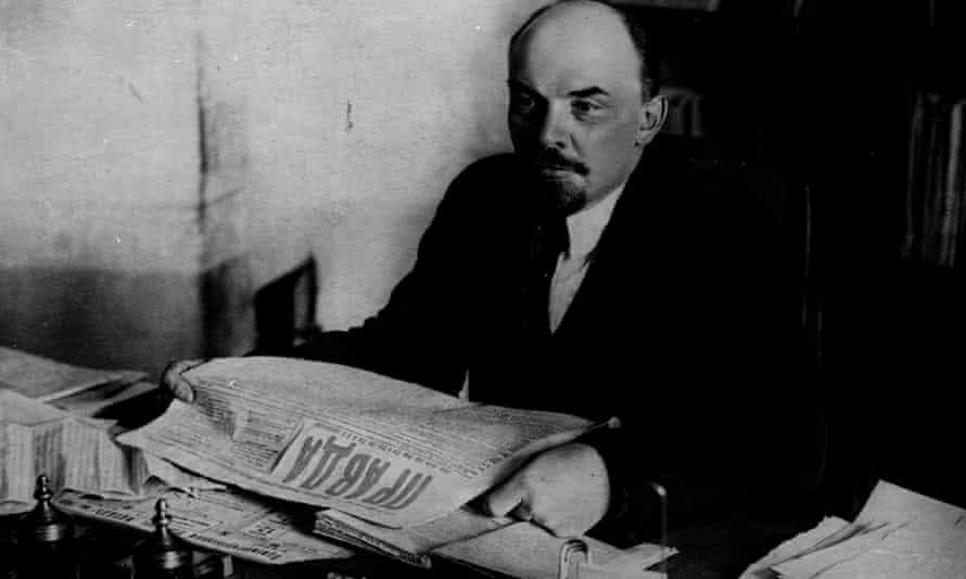 Lenin reading a copy of Pravda in 1920.