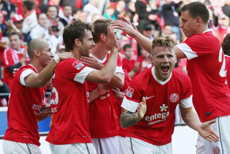 Andreas Ivanschitz (second from left) celebrates a Mainz goal in September 2012. 'I've never seen a coach have the courage to be simple before,' he says of Tuchel's methods.