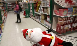 A stuffed santa toy is seen in a shopping trolley at a Sainsbury's store in London