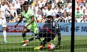 Kelechi Iheanacho of Manchester City scores for his side five minutes into the match at Swansea City