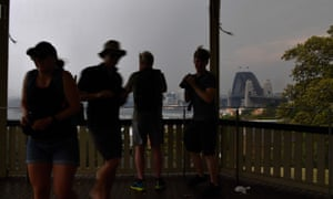 Tourists take shelter in the rotunda at Observatory Hill as an electrical storm batters Sydney
