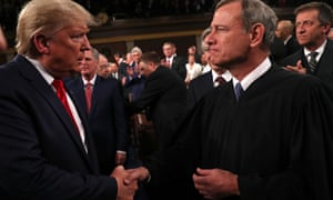 Trump shakes hands with the supreme court chief justice, John Roberts, before the State of the Union address last week