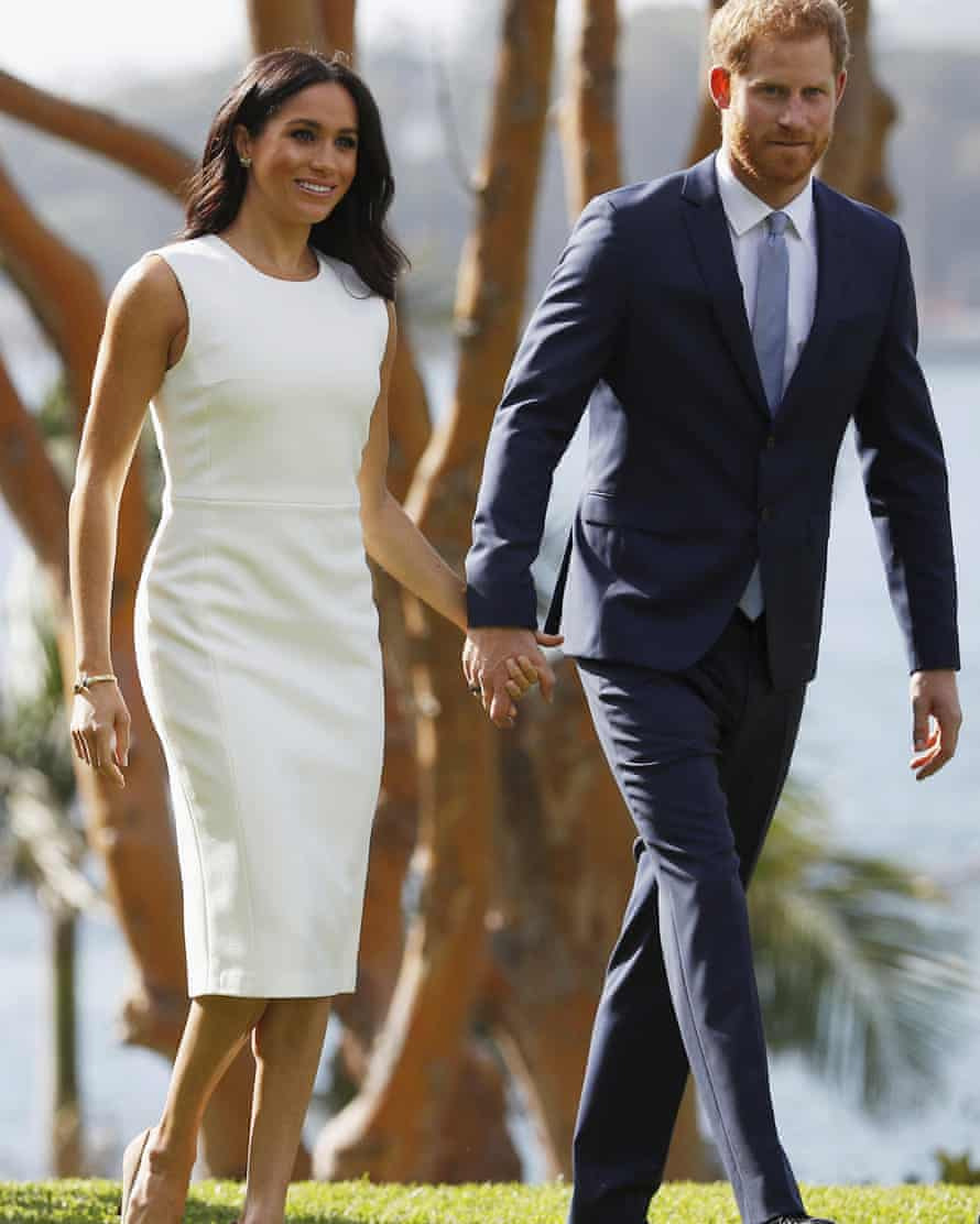 Prince Harry and Meghan walk on the lawns at Admiralty House in Sydney