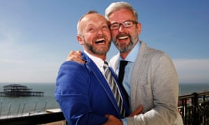 Andrew Wale (right) and Neil Allard laugh as they pose after marrying in Brighton in one of the first same-sex weddings in March 2014.