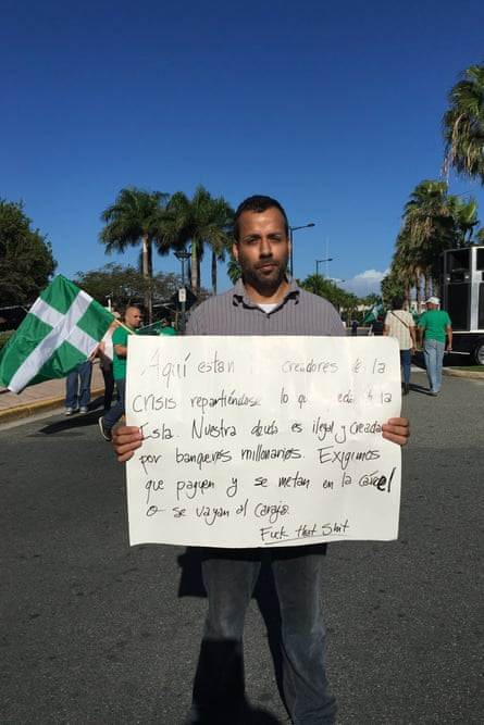 "Puerto Rico protester Amado Martinez Lebron. He described the rich investors coming to Puerto Rico as ""the people destroying our country"". ""John Paulson is responsible for what's wrong with our country,"" he said. ""He is bringing all these rich people who don't have to pay tax while we suffer."""