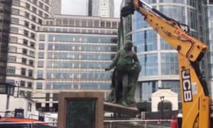 A statue of Scottish slaveholder Robert Milligan being removed from West India Quay, east London on Wednesday.