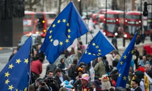 Protesters march on Downing Street with EU flags. Davis says article 50 letter not a threat to union.