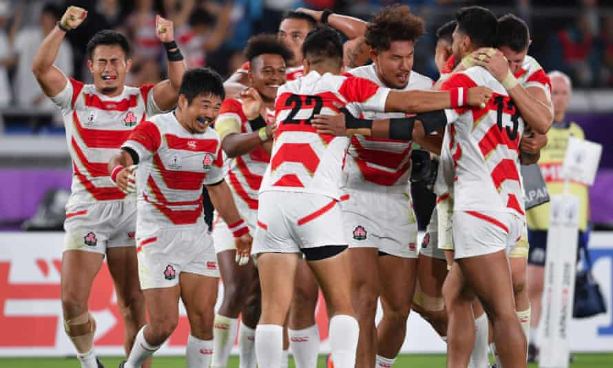 Japan celebrate after the defeat of Scotland in the group stage