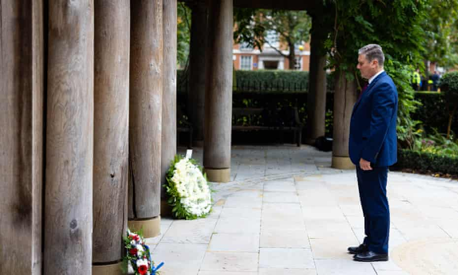 The Labour leader, Sir Keir Starmer, lays flowers in the September 11 Memorial Garden in Grosvenor Square, London, to mark the 20th anniversary of the terrorist attack.