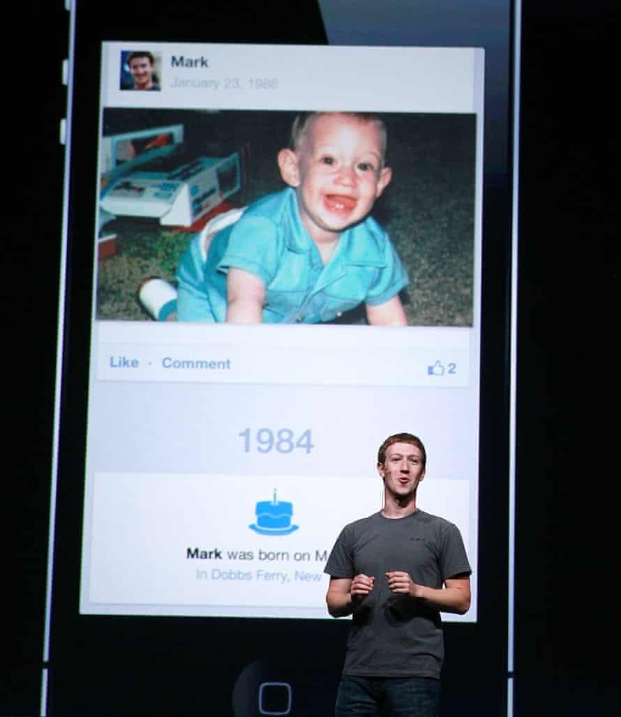 Facebook CEO Mark Zuckerberg shows a photo of himself as a baby.