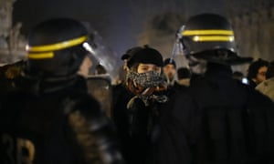 Protesters confront riot police in Paris.