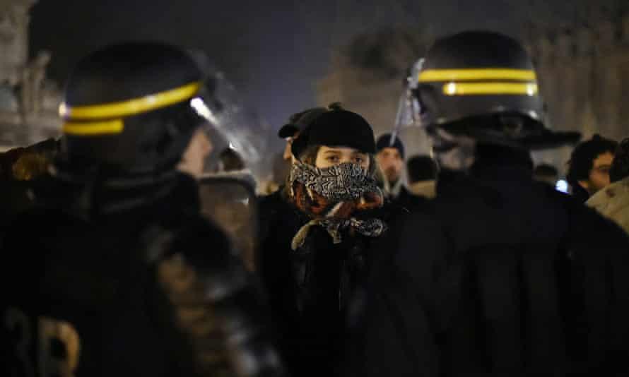 Protesters confront riot police in Paris.