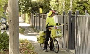 Australia Post apologises after delivering postcard 50 years